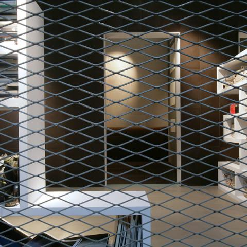 Pareti divisorie in lamiera stirata trasparente - Stand fieristico